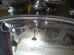 An ANTIQUE SILVER PLATED SELF POURING TEAPOT SET AND TRAY JAMES DIXON