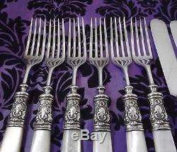 Fancy Wm A Rogers Mother of Pearl Handle 12 Pc Flatware Set withSterling Ferrules