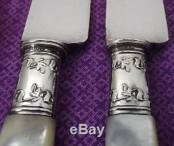 Landers Frary & Clark Mother of Pearl Handle 12 Pc Flatware Set withSterling Bands